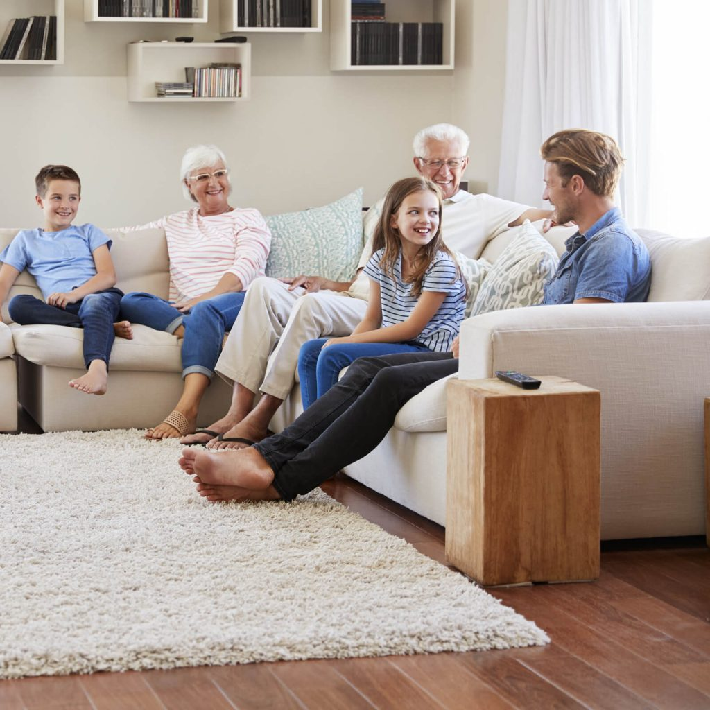Family gosping in living room in Greenville, SC | Lake Forest Flooring